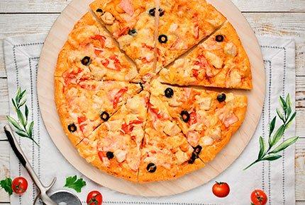 Большой круг пиццы со скидкой 50% в «MAYA PIZZA» на Ленина